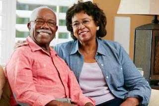 older couple sitting together on couch I dentist in moline il
