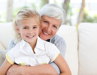 older woman with young girl sitting on lap I dentist in moline il
