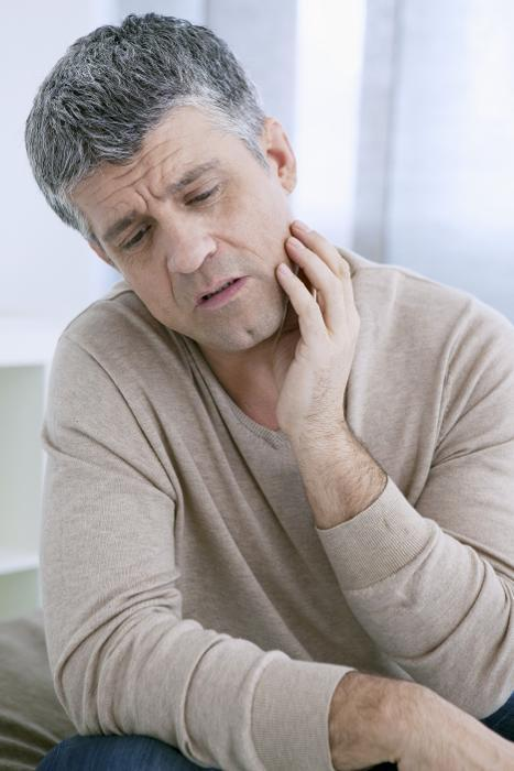Man in Tooth Pain | Root Canals Moline, IL