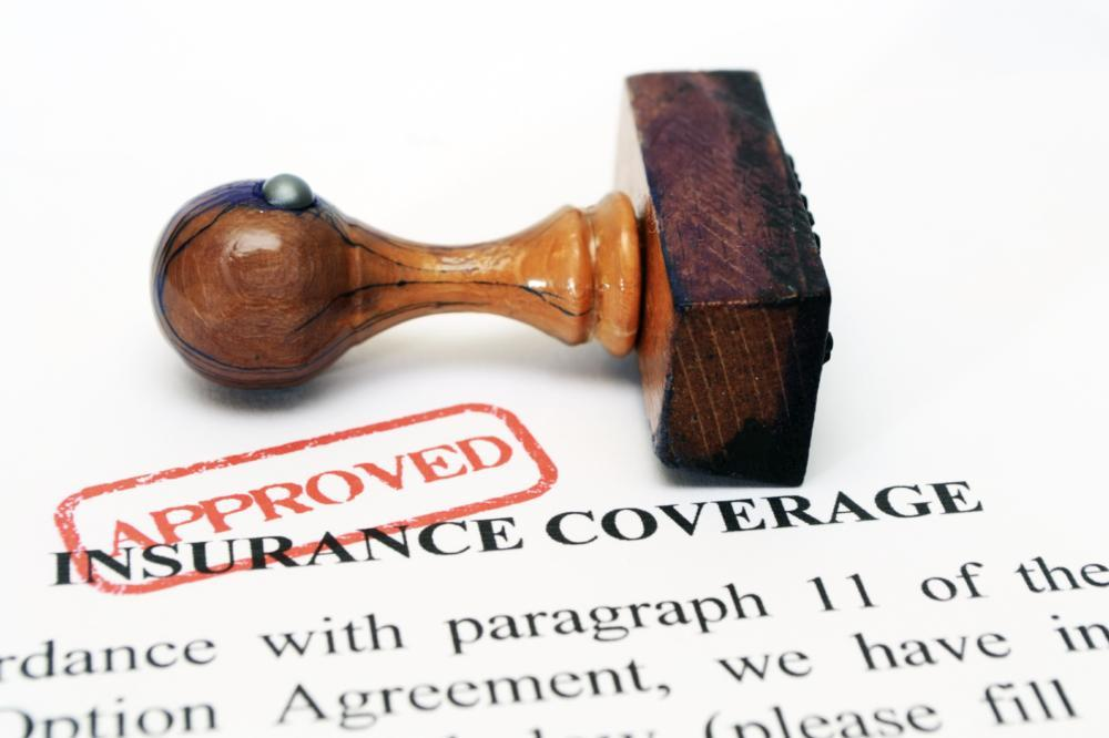 Image of a stamp of approval on insurance papers