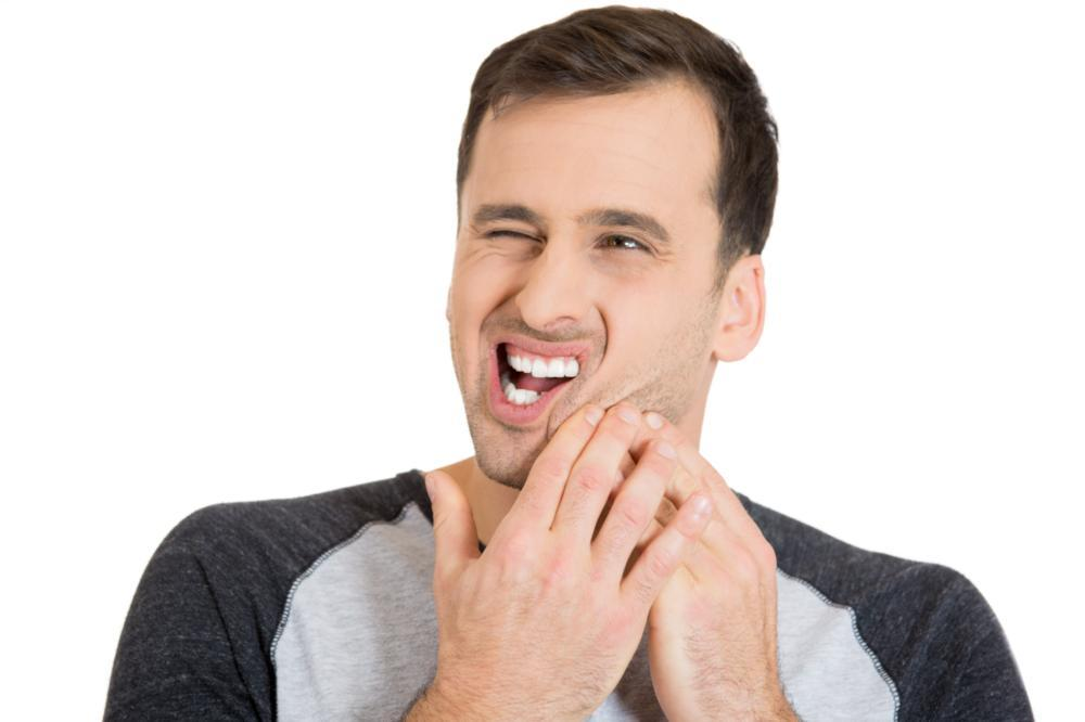 Image of individual with a sore jaw