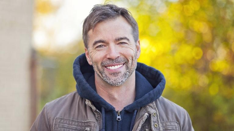 Man smiling outside | CEREC Dental Crowns Moline IL