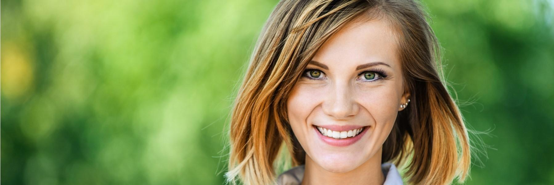 Young woman smiling l Dental Implants in Moline, IL